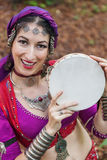 Oriental Dancer. With tambourine in the park Stock Photo