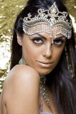 Oriental dancer woman. Portrait of a beautiful oriental dancer with a tipical egyptian make up Royalty Free Stock Photography
