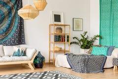 Oriental design in interior. Oriental design in small studio interior with wooden furniture royalty free stock image