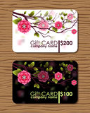 Oriental designed gift card with branches of japanese cherry flowers. Royalty Free Stock Photography