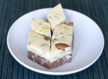Oriental dessert halva with pistachio, almond, cashew nuts, peanut, walnut  on a  plate. Image. Healthy food. closeup of sweets. From Iran popular in many other royalty free stock photos