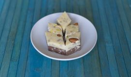 Oriental dessert halva with pistachio, almond, cashew nuts, peanut, walnut  on a  plate. Image. Healthy food. closeup of sweets. From Iran popular in many other stock photo