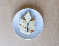 Oriental dessert halva with pistachio, almond, cashew nuts, peanut, walnut  on a  plate. Image. Healthy food. closeup of sweets. From Iran popular in many other royalty free stock photo