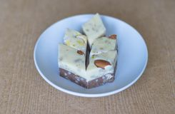 Oriental dessert halva with pistachio, almond, cashew nuts, peanut, walnut  on a  plate. Image. Healthy food. closeup of sweets. From Iran popular in many other stock image