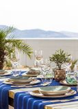 Oriental dining table arrangement with mountain and seaview stock photography