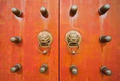 Oriental door and knobs Royalty Free Stock Photos