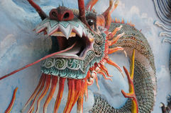 Oriental dragon statue against a wall Royalty Free Stock Photography
