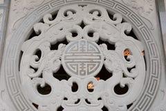 Oriental dragon stone pattern. Oriental stone pattern on a wall Royalty Free Stock Photos