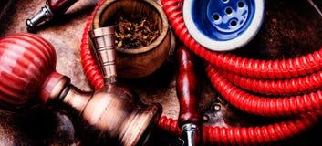 Smoking hookah with tobacco. Oriental exotic hookah .Smoking turkish shisha.Tobacco in a snuffbox and hookah royalty free stock photo