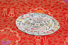 Oriental fabric brocade. China red traditional embroidery patterns Stock Photography