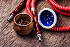 Smoking hookah with tobacco royalty free stock images