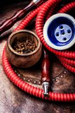 Smoking hookah with tobacco royalty free stock photography