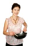 Oriental female with wok Stock Photography