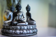 Oriental figure of meditation in a therapy center Stock Image