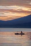 Oriental fisherman in the sea in the morning. Oriental fisherman in the sea at sunrise Royalty Free Stock Photo