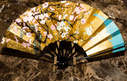 Oriental folding paper hand fan. Royalty Free Stock Photography