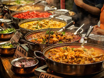 Oriental food. Indian takeaway at a London's market Stock Photography