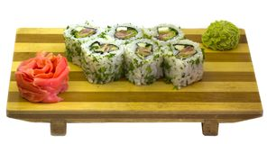 Oriental food, Japanese food. Raw fish, sushi, sushi on wooden plate Royalty Free Stock Photo