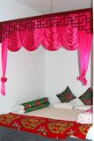 Oriental four poster bed with handicrafts in Pingyao, China Royalty Free Stock Image