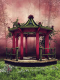 Oriental gazebo on a spring meadow Royalty Free Stock Photo