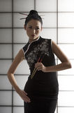 Oriental girl with chopstick Stock Photo