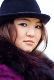 Oriental girl in coat Royalty Free Stock Images