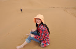 Oriental girl in desert Royalty Free Stock Image