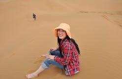 Oriental girl in desert Royalty Free Stock Image