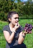 Oriental girl with grape Royalty Free Stock Photos