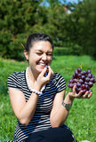 Oriental girl with grape Royalty Free Stock Image