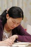 Oriental Girl On Writing Stock Image