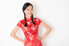 Oriental girl in red qipao smiling Royalty Free Stock Photo