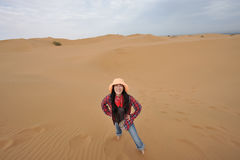 Oriental girl smiling in desert Royalty Free Stock Images