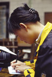 Oriental girl on writing. It is a Oriental girl on writing. a chinese girl Stock Photo