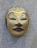 Oriental goddess mask. In ancient oriental ritual, mask play an important role. mask have been given a mysterious religious and folk meaning. the mask is a Stock Photo