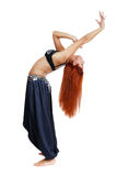 Oriental grace. Red-headed bellydancer in oriental costume bending backwards Stock Images