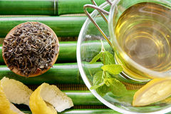 Oriental green tea with mint and lemon on bamboo top Royalty Free Stock Photography