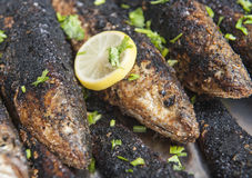Oriental grilled fish at a hotel restaurant buffet Royalty Free Stock Photos