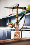 Oriental hookah. A traditional oriental hookah at the window edge royalty free stock photo