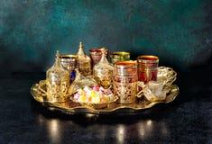 Oriental hospitality Ramadan Tea table golden glasses Royalty Free Stock Image