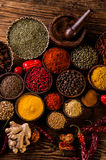 Oriental hot spices on wooden table Stock Photos