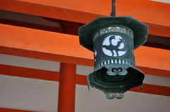 Oriental iron lantern. A closeup of an oriental iron lantern with a motif of a bird carved on it. These lanterns are distinctive and hung in Heian jingu, Kyoto royalty free stock images
