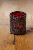 Oriental iron lantern on wooden table Royalty Free Stock Photo