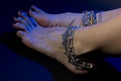 Oriental jewelry: female feet with beautiful jewellery national Stock Photos