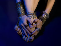 Oriental jewelry: female feet and hands with beautiful jewellery Stock Photography