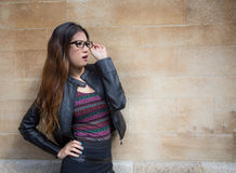 Oriental lady with glasses looking thoughtful in city Royalty Free Stock Images