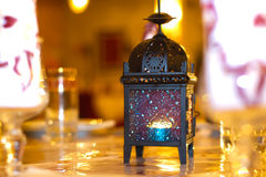 Oriental lamp with gloden background at wedding. Oriental lamp on table at wedding Royalty Free Stock Photos