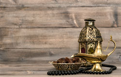 Oriental lamp, lantern, rosary dates still life stock photography