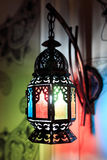 Oriental lamp on the wall. Oriental lantern with colored glass on the wall Stock Photos