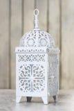 Oriental lantern on wooden table Royalty Free Stock Photos
